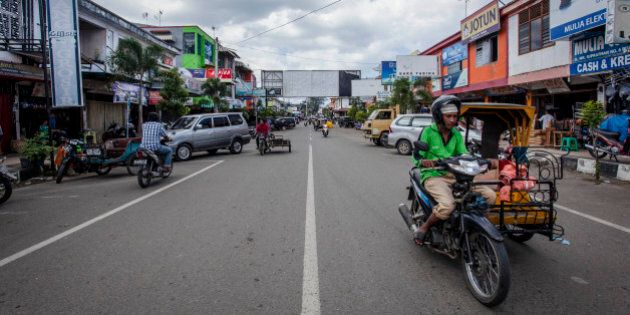 BANDA ACEH, INDONESIA - DECEMBER 10: People drive along W.R Supratman street prior to the ten year anniversary...
