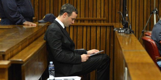 PRETORIA, SOUTH AFRICA - JULY 3: Oscar Pistorius sits in the dock at the Pretoria High Court on July...