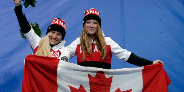 The team from Canada CAN-1, pilot Kaillie Humphries, left, and brakeman Heather Moyse, celebrate their...