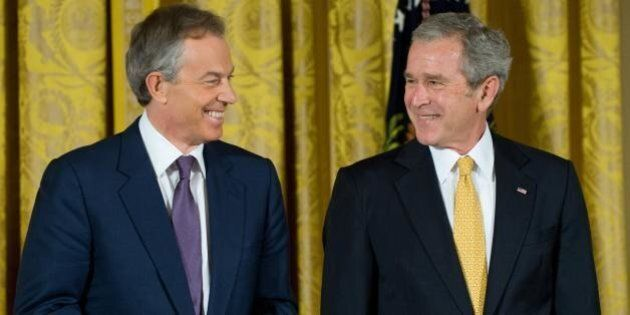 US President George W. Bush smiles alongside former British Prime Minister Tony Blair (L) prior to presenting him with the Presidential Medal of Freedom in the East Room of the White House in Washington, DC, January 13, 2009. The award, the highest US civilian award, was also presented to Australia's former Prime Minister John Howard and Colombian President Alvaro Uribe. AFP PHOTO / Saul LOEB (Photo credit should read SAUL LOEB/AFP/Getty Images)