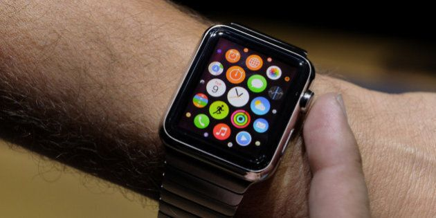 An attendee demonstrates the Apple Watch after a product announcement at Flint Center in Cupertino, California,...