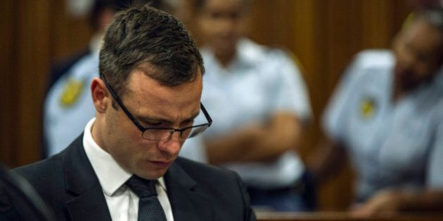 Oscar Pistorius sits in court in Pretoria, South Africa, Friday, Oct. 17, 2014, on the last day of sentencing...