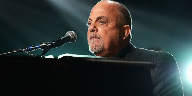 NEW YORK, NY - DECEMBER 12: Billy Joel performs at '12-12-12' a concert benefiting The Robin Hood Relief...