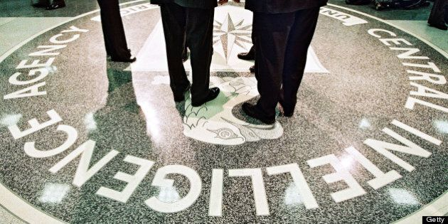 386984 06: President George W. Bush, Central Intelligence Agency Director George Tenet and others stand...