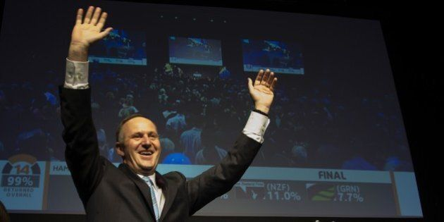 New Zealand Prime Minister John Key celebrates after winning the general election at the 2014 New Zealand...