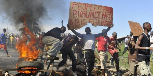 Burundian men take part in a protest against the president's bid to cling to power for a third term in...