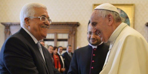 Pope Francis (R) shakes hands with Palestinian authority President Mahmud Abbas (L) after they exchanged...