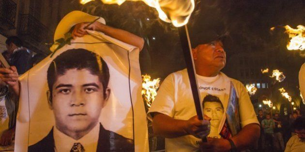 Students of the Ayotzinapa school and parents of the 43 missing students take part in a protest in Guadalajara...