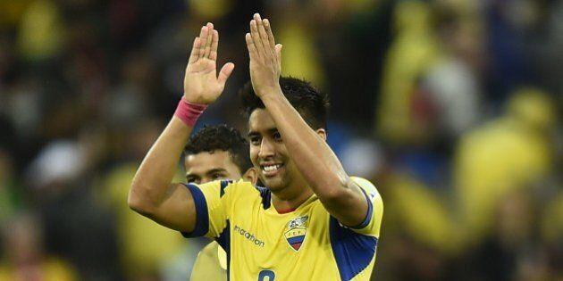 Ecuador's midfielder Christian Noboa celebrates their victory at the end of a Group E football match...