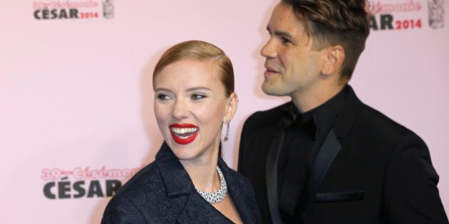 U.S. actress Scarlett Johansson, left, and her partner Romain Dauriac arrive at the 39th French Cesar...