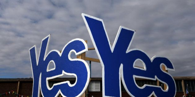 In this Monday, Sept. 8, 2014, file photo Yes Signs are displayed in Eyemouth, Scotland. If Scottish...