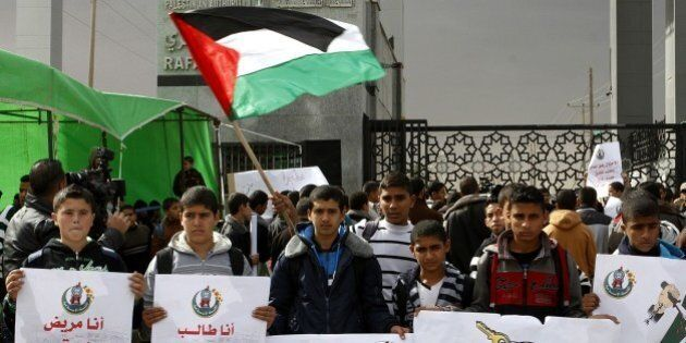 RAFAH, GAZA - NOVEMBER 23: A group of Palestinian students hold banners as they stage demonstration against...