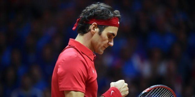 Switzerland's Roger Federer reacts after gaining a point against France's Richard Gasquet during their tennis match at the Davis Cup final between France and Switzerland at Stade Pierre Mauroy in Villeneuve-d'Ascq, northern France, on November 23, 2014.  AFP PHOTO / PHILIPPE HUGUEN        (Photo credit should read PHILIPPE HUGUEN/AFP/Getty Images)