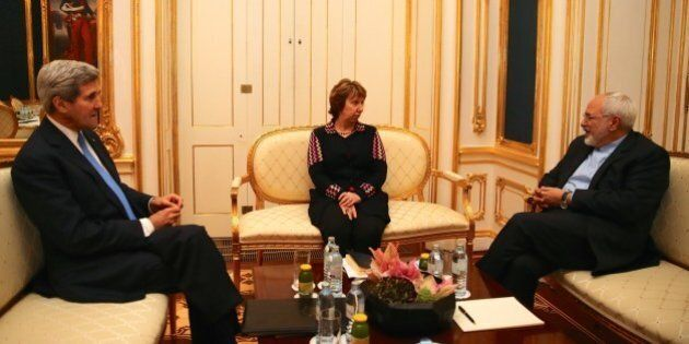 VIENNA, AUSTRIA - NOVEMBER 22: United States Secretary of State John Kerry (L) and  former EU Foreign Policy Chief Catherine Ashton (C) meet with Iranian Foreign Minister Mohammad Javad Zarif (R) as a part of negotiations over Iran's nuclear program in Vienna, Austia on November 22, 2014. (Photo by Hasan Tosun/Anadolu Agency/Getty Images)