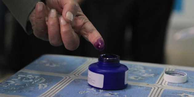 BEN AROUS, TUNISIA - NOVEMBER 23: A Tunisian voter's finger is inked after casting his vote at Nahc el-Keyrevan...