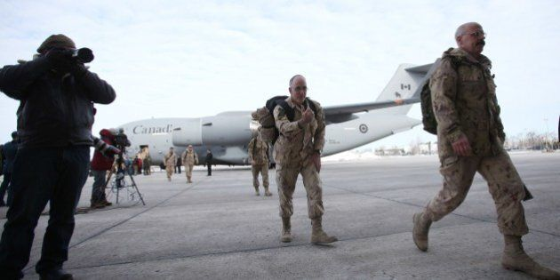 The last Canadian troops to leave Afghanistan, deplane as they return to Canadian soil, in Ottawa, Ontario...