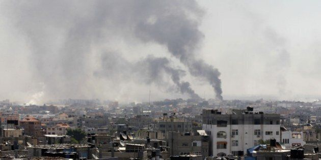 Smoke billows following an Israeli military strike east of Rafah in the southern Gaza Strip, on August...