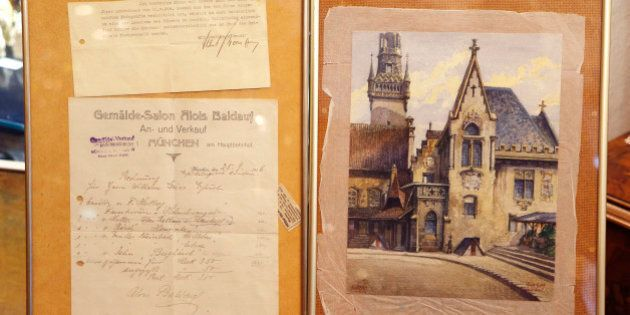 """The Wednesday, Nov. 19, 2014 photo shows a picture titled """"The Old City Hall"""", right, that - as the..."""