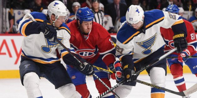 MONTREAL, QC - NOVEMBER 20: Brandon Prust #8 of the Montreal Canadiens fights for the puck against Paul...