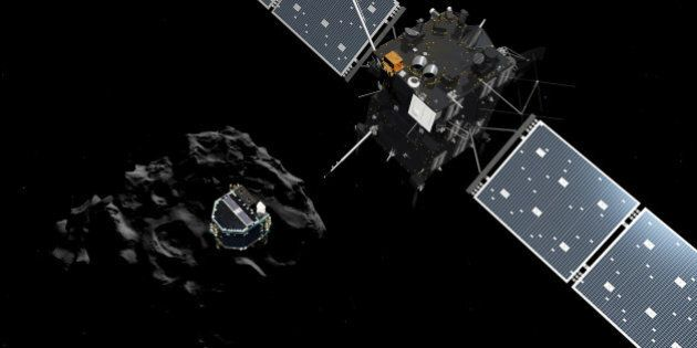 DARMSTADT, GERMANY - NOVEMBER 12:  (EDITORIAL USE ONLY) In this November 12, 2014 handout photo illustration provided by the European Space Agency (ESA) the Philae lander (C) is pictured descending onto the 67P/Churyumov-Gerasimenko comet after a successful separation from the Rosetta probe. ESA will attempt to land the Philae lander onto the comet in the afternoon (GMT) of November 12 which, if successful, will be the first time ever that a man-made craft has landed onto a comet. The Philae lander, launched from the Rosetta probe, is a mini laboratory that will harpoon itself to the surface, though a problem with a gas thruster detected November 11 is making the outcome of the landing uncertain.   (Photo ESA via Getty Images)