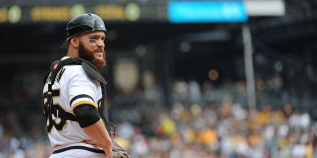 PITTSBURGH, PA - SEPTEMBER 21:  Catcher Russell Martin of the Pittsburgh Pirates looks on from the field during a game against the Milwaukee Brewers at PNC Park on September 21, 2014 in Pittsburgh, Pennsylvania.  The Pirates defeated the Brewers 1-0. (Photo by George Gojkovich/Getty Images)