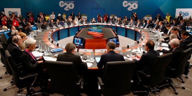Leaders meet at the first plenary session at the G20 summit in Brisbane, Australia Saturday, Nov. 15,...