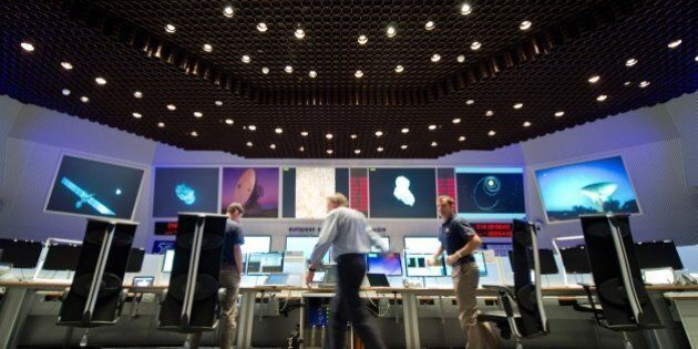 Scientists follow the flight of the Rosetta spacecraft from the control centre of the European Space...