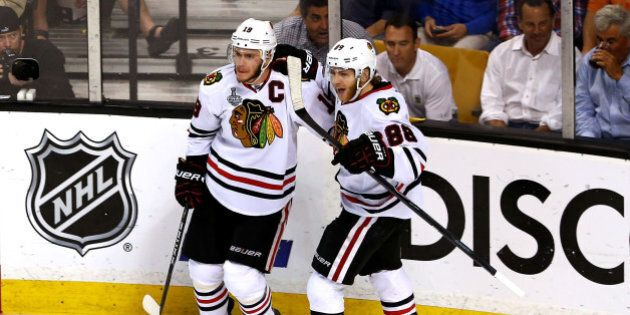 BOSTON, MA - JUNE 24: Jonathan Toews #19 of the Chicago Blackhawks celebrates with teammate Patrick Kane...