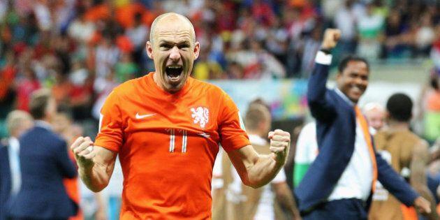 SALVADOR, BRAZIL - JULY 05: Arjen Robben of the Netherlands screams as he celebrates victory after the...
