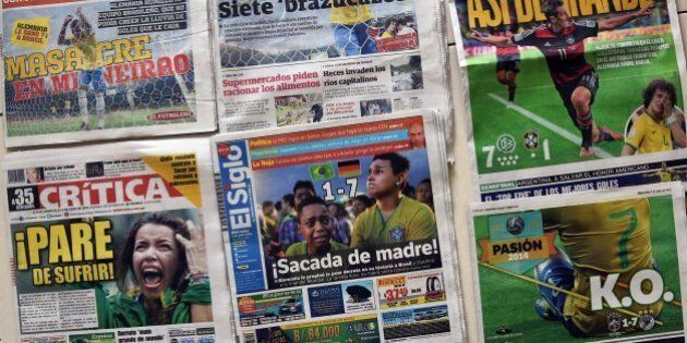 Picture of Panama's newspapers taken on July 9, 2014 a day after Germany beat Brazil with a record 7-1...