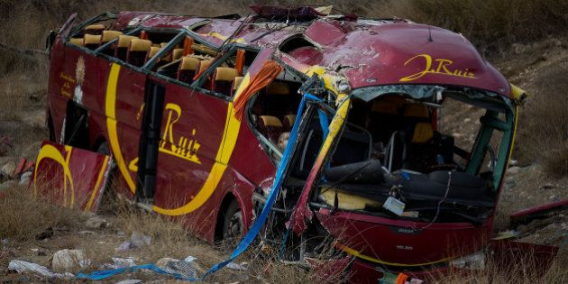 VENTA DEL OLIVO, SPAIN - NOVEMBER 09: A general view of the crashed bus in which 13 people died on November...