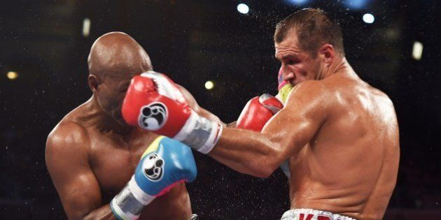 Bernard Hopkins of the US (L) fights against Sergey Kovalev of Russia during their IBF, WBA and WBO light...