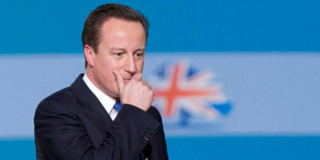 David Cameron, U.K. prime minister, gestures following his speech at the Conservative party's annual...