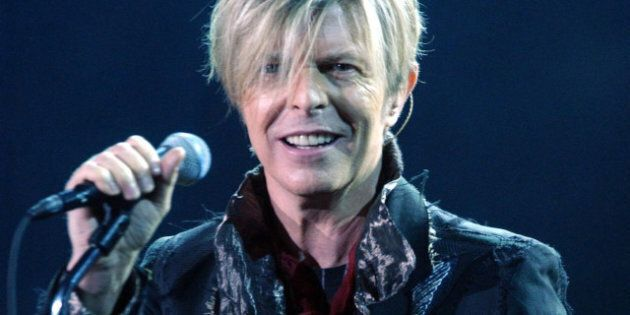 File photo dated 25/11/2003 of David Bowie performing at Wembley Arena, as the singer's surprise and...