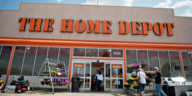 A customer walks into a Home Depot Inc. store in Peoria, Illinois, U.S., on Friday, Aug. 16, 2013. Home Depot Inc., the largest U.S. home-improvement retailer, posted second-quarter profit that topped analysts' estimates and raised its annual forecast as shoppers buoyed by the housing recovery spend more on projects. Photographer: Daniel Acker/Bloomberg via Getty Images