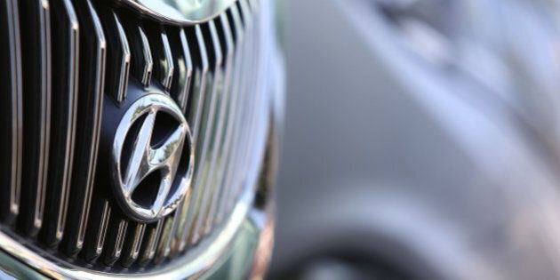 The Hyundai Motor Co. badge is displayed on the front grille of a 5G Grandeur sedan at one of the company's...