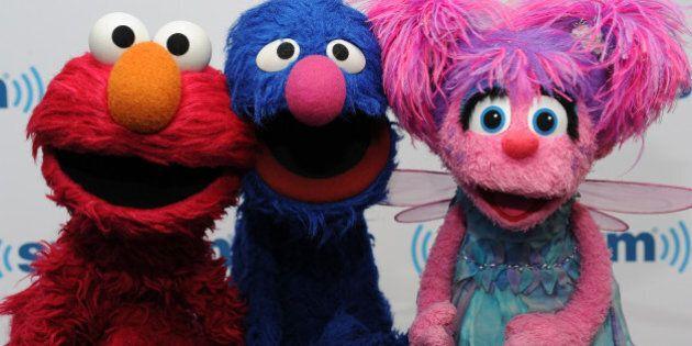 NEW YORK, NY - SEPTEMBER 12: (L-R) Elmo, Grover and Abby Cadabby of Sesame Street visit at SiriusXM Studios...