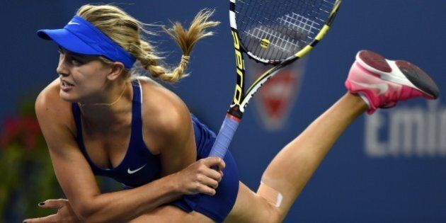 Eugenie Bouchard of Canada serves to Sorana Cirstea of Romania during their US Open 2014 women's singles match at the USTA Billie Jean King National Center August 28, 2014  in New York. AFP PHOTO/Don Emmert        (Photo credit should read DON EMMERT/AFP/Getty Images)