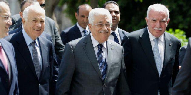Palestinian President Mahmoud Abbas, center, arrives with the Arab League's Secretary-General Nabil Elaraby,...