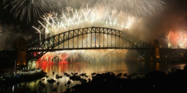 SYDNEY, AUSTRALIA - DECEMBER 31: Fireworks explode off the Sydney Harbour Bridge during the midnight...