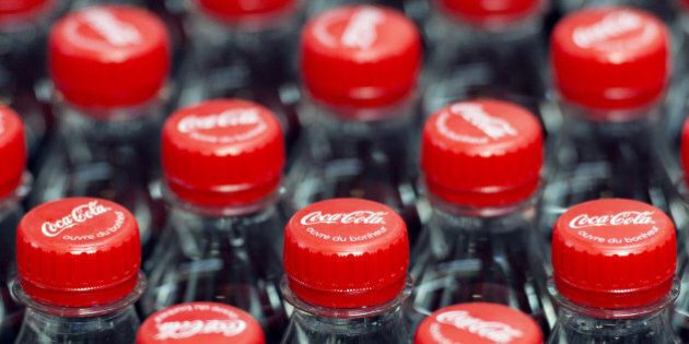 This photo taken on June 7, 2013, in Clamart, near Paris, shows newly produced Coca-Cola soft drink bottles on an assembly line at a Coca Cola bottling plant.  AFP PHOTO / LIONEL BONAVENTURE        (Photo credit should read LIONEL BONAVENTURE/AFP/Getty Images)