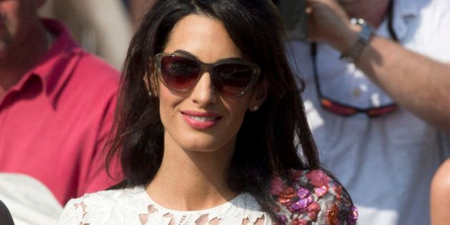 Amal Alamuddin leaves the Aman hotel in Venice, Italy, Sunday, Sept. 28, 2014. George Clooney and Amal married Saturday, Sept. 27, the actor's representative said, out of sight of pursuing paparazzi and adoring crowds.(AP Photo/Andrew Medichini)