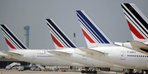 Air France planes are parked on the tarmac of Charles de Gaulle airport on September 24, 2014 in Roissy,...