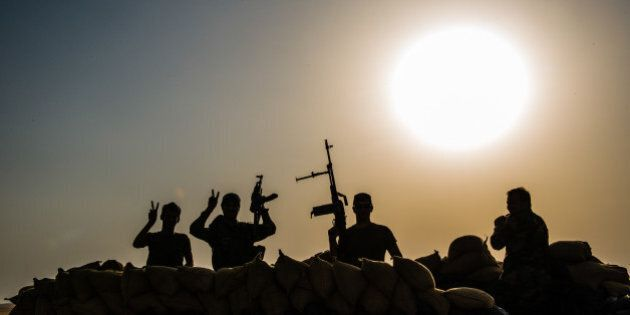 KAHIR FRONT LINE, ERBIL, IRAQ - 2014/08/26: Peshmerga soldiers watch and wait for the Islamic state to...