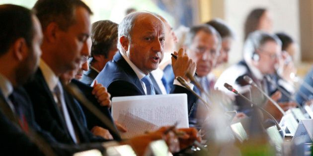 French Foreign Minister Laurent Fabius, center, attends an international conference intended to come...