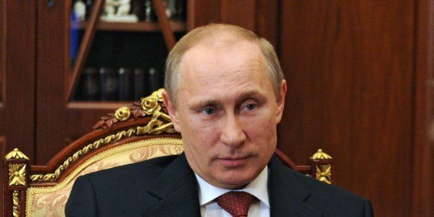 Russia's President Vladimir Putin attends a meeting in the Kremlin in Moscow, on May 5, 2014. German...