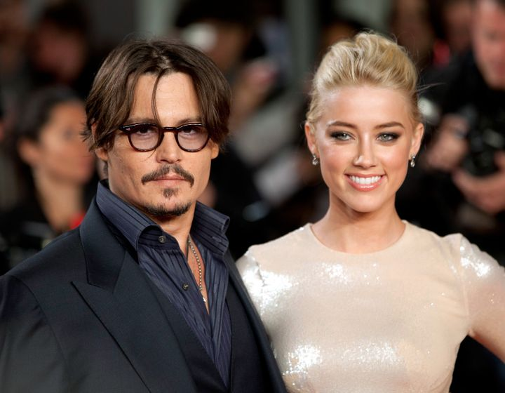 "Johnny Depp and Amber Heard attend the premiere of ""The Rum Diary"" in London when they were still a couple."