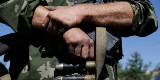 A Pro-Russian rebel holds the ammo in the village of Hrabske, eastern Ukraine, Sunday, Aug. 31, 2014....
