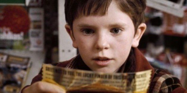 """FREDDIE HIGHMORE as Charlie Bucket in Warner Bros. Pictures' fantasy adventure """"Charlie and the Chocolate..."""