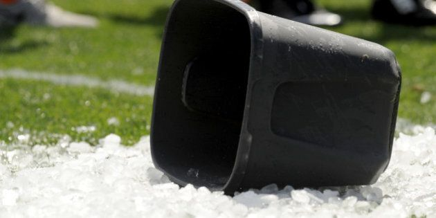 BEREA, OH - AUGUST 15, 2014: A bucket lies on top of ice on the field after members of the Cleveland...